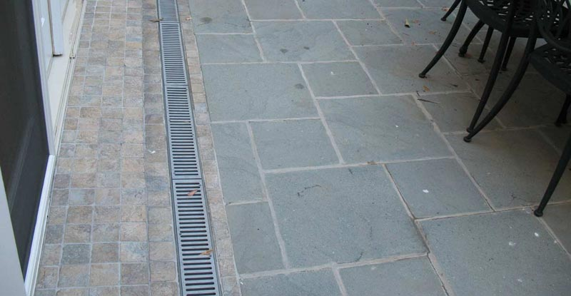 Patio drainage solutions enclosed