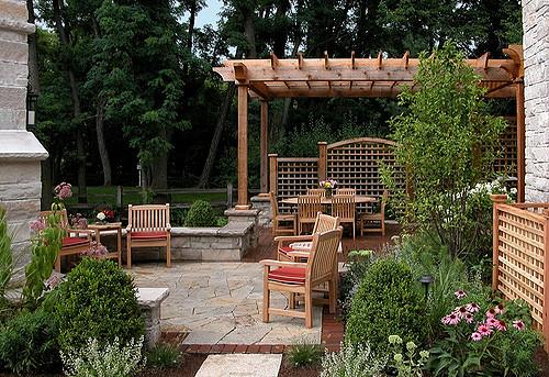 brick stone trellis patio cedar stonewall flagstone pergola perennials gardenstructures gardendesign landscapedesign outdoorfireplace outdoorroom sittingwall
