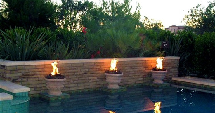 Outdoor fire bowls for pools
