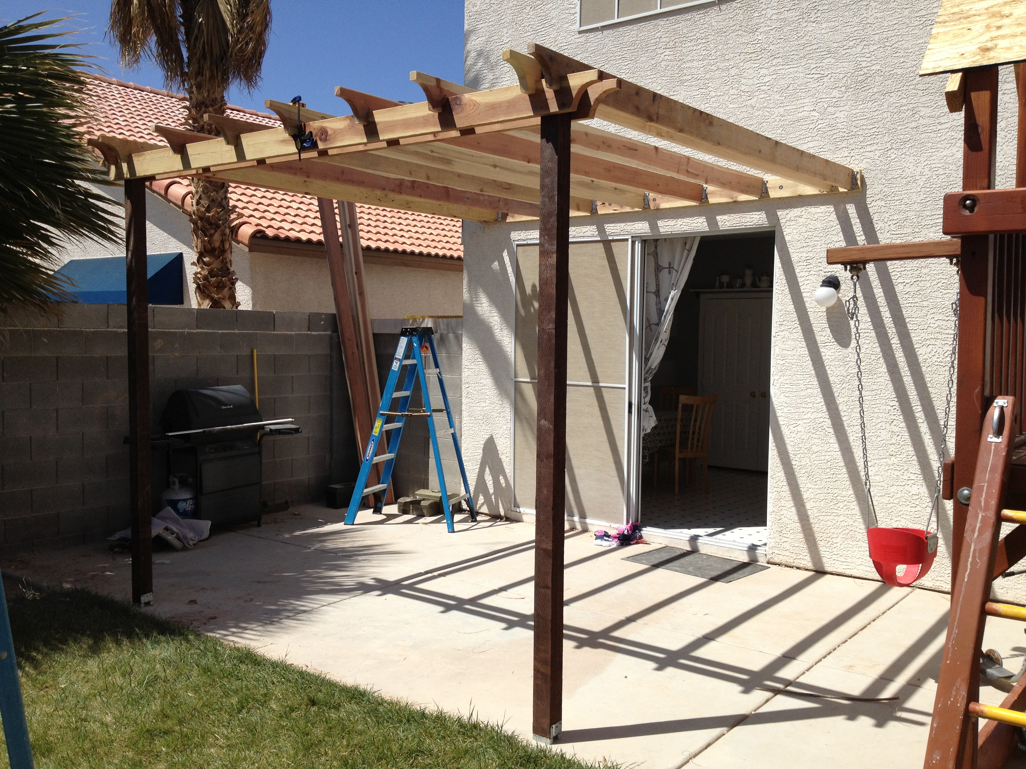 Garden treasures how to build a covered pergola attached for How to build a house yourself