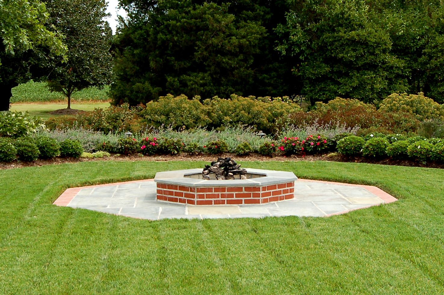 Incredible landscape brick fire pit garden landscape for Landscaping companies