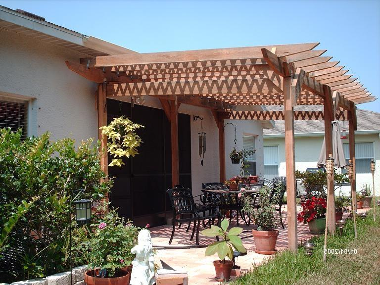 Review how to build a pergola attached to your house for Building onto a house
