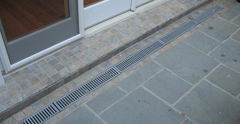 Patio drainage solutions raised