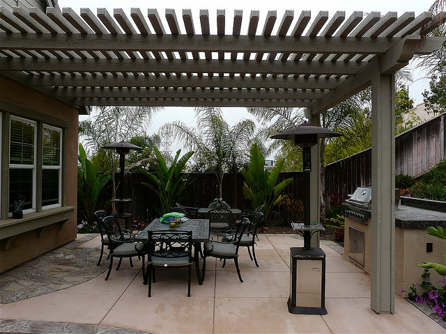 Wood patio cover attached to house